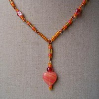 Pumpkin Heart Necklace by AthomicArtandDesign on Zibbet
