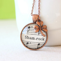 Saint Patrick's Day jewelry.  Shamrock necklace made with vintage sheet music and copper charm.