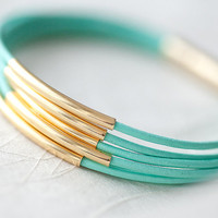 Mint Green Leather Bracelet with 6 Golden tubes by by pardes