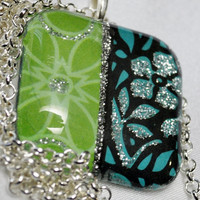 Art pendant with floral in lime and aqua on silver