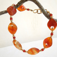 Orange Carnelian Bracelet with Floating Gold Beads by seemomster
