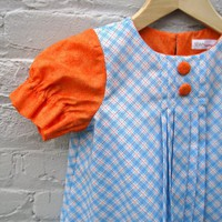 Supermarket: girl&#x27;s Audrey dress in orange and blue plaid from SewnNatural
