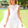White Sleeveless Dress with Cutout High Round Neckline