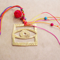 Eye sculpture charm, brass eye charm with colorful cords