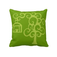 Green tree  Bird in the cage Throw Pillow from Zazzle.com