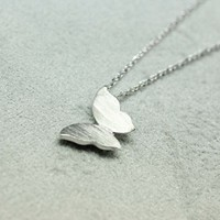 Butterfly charm pendant necklace in silver