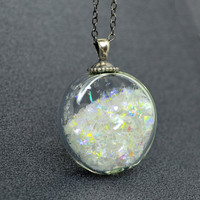 Iridescent snow flake glitter in flat round blown by thestudio8