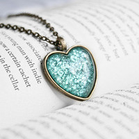 A Mermaid&#x27;s Tail Heart Pendant Necklace