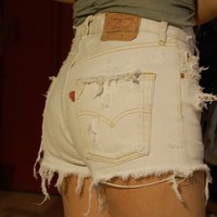 destroyed white levis high waisted cut offs from Deadenim