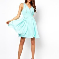 Little Mistress Jewelled Pleat Wrap Front Prom Dress at asos.com