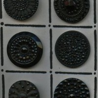 Antique hand pressed black glass buttons