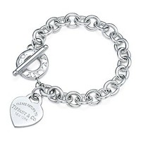 Tiffany &amp; Co. -  Return to Tiffany medium heart tag in silver on a toggle bracelet, medium.