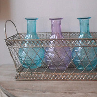 wedding table decoration .. Spring aqua and purple bottles in Silver mesh Basket ... vases basket