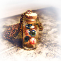 Eyeballs in a bottle necklace / miniature by UraniaArt on Etsy