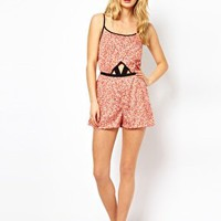 River Island Harriet Cut Out Ditsy Print Playsuit at asos.com