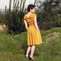 HOLLY GOLIGHTLY in MUSTARD - Muted yellow dress with pockets // pleated skirt // back cut out &amp; bow // bridesmaid dress // vintage inspired