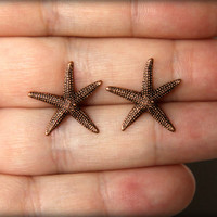 Starfish Earrings in Aged Copper by saffronandsaege on Etsy