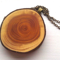 Redbud Wood Slice Pendant Necklace by hippopotamuspie on Etsy