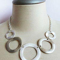 LAVISHY multi silver circle necklace.