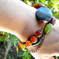 Multi strand beaded bracelet, copper chain, stone, turquoise, horn, glass boho jewellery in blue, green, orange, brown, amber hues