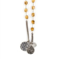 The Antique Bone Skull Necklace with Coin Pendants by jewelry designer Chan Luu