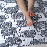 sheep organic baby quilt with black white lambs / by SewnNatural