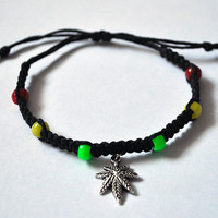 Jamaican Rasta Inspired Hemp Adjustable Bracelet with Marijuana Leaf Charm Red, Green, Yellow, and Black Hemp Rastafarian Colors
