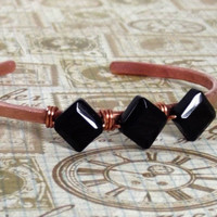 Modern and rustic hammered copper geometric cuff.