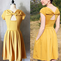 HOLLY GOLIGHTLY MUSTARD - Yellow dress with pockets // pleated skirt // back cut out // bridesmaid dress // vintage inspired // party // day