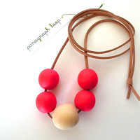 Neon pink beaded necklace, wood beads, suede cord