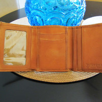 vintage Wilsons leather warm chestnut brown trifold wallet. cognac leather wallet. saddle tan wallet