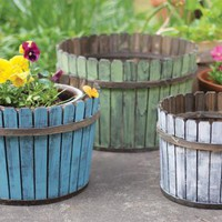 set of three round multi-colored slatted wooden baskets | wooden planters