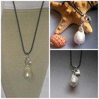 Huge Rare Tahitian flameball pearl with PMC Sterling silver heart necklace.