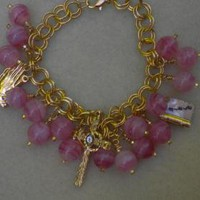 Pink Religious Charms Bracelet by IllusionsbyDonna on Zibbet
