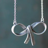 out and a-bow-t necklace in pewter