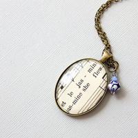 French sheet music necklace made with vintage sheet music and blue and white porcelain bead.  Romantic and dreamy ooak jewelry