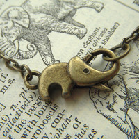 Tiny Elephant Necklace Antiqued Brass Bronze by CosmicFirefly
