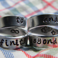 to infinity and beyond set of  two aluminum swirl style  rings 1/4 inch