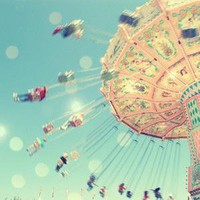 Vintage swings carnival ride photograph in pastel 