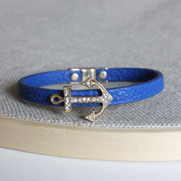 Sweet blue bracelet with a gold charm