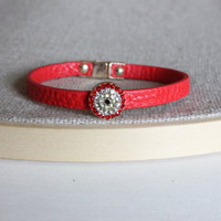Sweet red bracelet with a gold charm