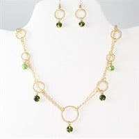 Gold necklace with green rhinestones and earrings