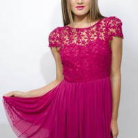 Beautiful Dress with little sleeves, lower back and Lace top