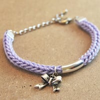 Bracelet with bow charm, silver plated bow and tube, lavender knit bracelet
