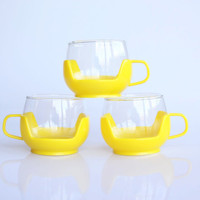 60s glass coffee or tea cups in yellow plastic holders, hot toddy glasses or picnic cups