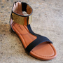 Black t-strap sandals in faux suede with a with metallic gold plate | shopcuffs.com