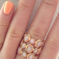 Gold-Tone Ring with Oval Circular Stone Detail