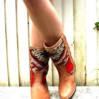Tan leather vintage Navajo carpet boots from CustomVintage