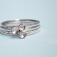Tiny flower stacking rings Sterling silver brush surface by Hoas