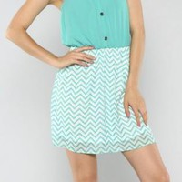 Mint Green Dress with Cinched Waist and Chevron Bottom